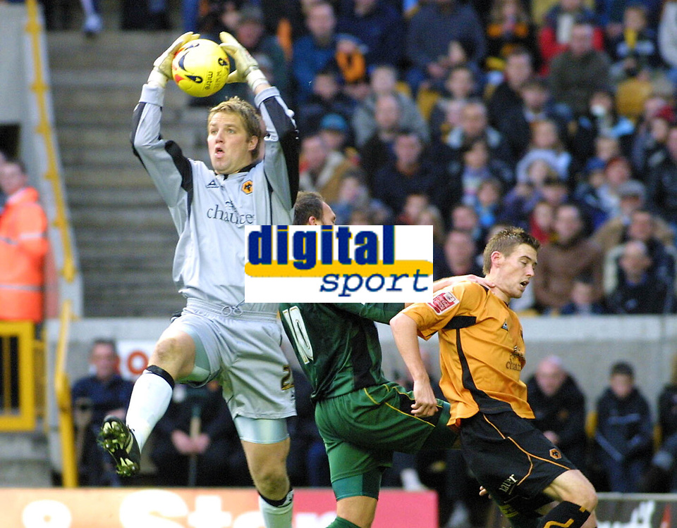 Photo: Dave Linney.<br />Wolverhampton Wanderers v Norwich City. Coca Cola Championship. 05/11/2005. Wolves keeper Stefan Postma collects the ball despite the attention of Dean Ashton(Norwich)