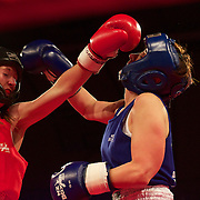 Linda Coultrip (red) and Teresa Wallace (blue) in action during the 'Thriller in the Chiller' charity boxing event as part of the Queenstown Winter Festival at the Queenstown Events Centre , South Island, New Zealand, 25th June 2011