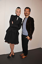 DAPHNE GUINNESS and MATTHEW WILLIAMSON at the Graduate Fashion Week Gala drinks reception held at Earls Court 2, London on 13th June 2012.