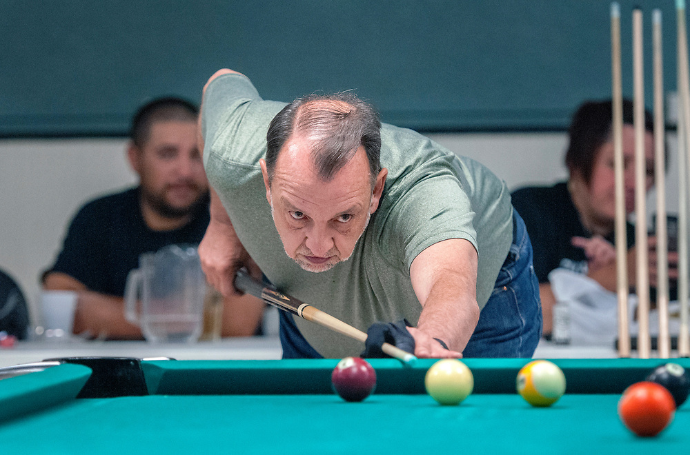 em071817i/jnorth/Donald Quintana, a member of the Saloon Shots billards team, plays 9 ball at the Faternal Order of the Eagle club, in Las Vegas, Tuesday July 18, 2017. The billards team is headed to Las Vegas Nevada to compete nationally. (Eddie Moore/Albuquerque Journal)