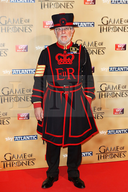 © Licensed to London News Pictures. 18/03/2015, UK. Crawford Henry Butler - Tower of London's longest serving Yeoman Warder,, Game of Thrones - Series Five World Premiere, Tower of London, London UK, 18 March 2015. Photo credit : Richard Goldschmidt/Piqtured/LNP