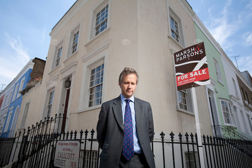 photo by ©2007 tom wagner 2007, all rights reserved. ©tom wagner 2007, all moral rights asserted..portrait of Peter Rawlings, previously a senior executive with Foxtons Estate Agents, now with Marsh Parsons Estate Agents. Photographed in Nottinghill Gate, London, in front of a house Marsh Parsons has recently accepted an offer on; the approx. 1400 sq. ft. house was marketed at 1.8  million pounds, but was concluded at 1.9 million GBP (the is approx. $3.8 million US dollars)