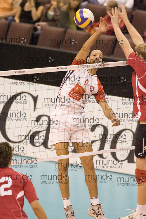 Khaled Belaid of Tunisia defeating Canada Two three games to none in the 2006 Anton Furlani Volleyball Cup, held in Ottawa, Canada. .Anton Furlani Cup.Copyright Sean Burges / Mundo Sport Images, 2006