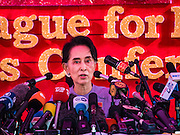 "05 NOVEMBER 2015 - YANGON, MYANMAR: AUNG SAN SUU KYI answers reporters' questions during a press conference. During the press conference, which lasted 90 minutes, Aung San Suu Kyi, the leader of the National League for Democracy (NLD), said that if the NLD won the election she would serve ""above"" the President. When questioned about the Rohingya crisis in western Myanmar, a reporter called the situation ""dramatic"" and Suu Kyi replied the entire country is in a ""dramatic situation"" and the problems of the Rohingya should not be ""exaggerated."" She said the ""great majority of our people remain as poor as ever."" She also said the NLD would make a ""fuss"" if election results were ""suspicious."" Citizens of Myanmar go to the polls Sunday November 8 in what is widely viewed as the most democratic and contested election in Myanmar's history. The NLD is widely expected to win the election.   PHOTO BY JACK KURTZ"
