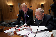 "MICHAEL HURLEY consults with Former Rep. LEE HAMILTON (D-IN), former vice chairman of the National Commission on Terrorist Attacks Upon the United States, as he prepares before testifing before the Senate Homeland Security and Governmental Affairs Committee on the ""9/11 Commission Report 10 Years Later."""