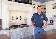 Tom Erger of Cabinet Studios in a model kitchen at 700 16th Street NE in Cedar Rapids on Tuesday, May 10, 2011.