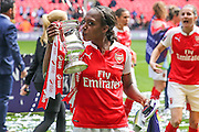 Arsenal Ladies forward Danielle Carter with the FA Cup during the SSE Women's FA Cup Final match between Chelsea Ladies and Arsenal Ladies at Wembley Stadium, London, England on 14 May 2016. Photo by Shane Healey.