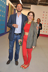 CHRISTOPHER HOARE and ALIX DUVERNOY at the opening of the Dairy Art Centre, 7a Wakefield Street, Bloomsbury, London WC1 on 24th April 2013.