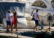 EXCLUSIVE<br /> John Terry new luxury yacht<br /> John Terry, English professional footballer, with his wife Toni visit and experience their new boat, a luxury yacht Sunseeker Portofino 40, worth half a million euros, anchored in the Marina of Vilamoura in Portugal, accompanied by a man and one unidentified woman.<br /> ©Exclusivepix