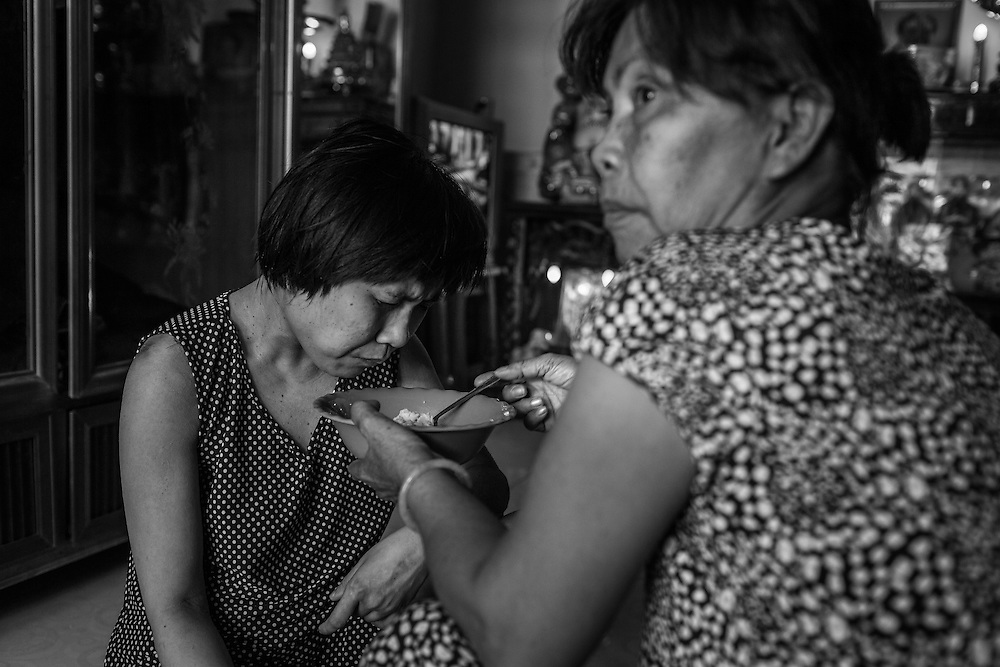 Hanh, 34, is fed by her mother in their home near the Bien Hoa airport, which was a storage and dispatch location for Agent Orange during the war, and well known today as still a hot spot of contamination.