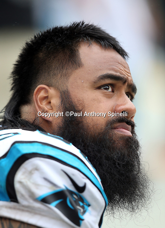 Carolina Panthers defensive tackle Star Lotulelei (98) looks on from the sideline during the 2015 NFL week 3 regular season football game against the New Orleans Saints on Sunday, Sept. 27, 2015 in Charlotte, N.C. The Panthers won the game 27-22. (©Paul Anthony Spinelli)