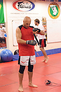 Randy Couture tapes up his gloves during a training session ahead of UFC 105 at Straight Blast Gym in Manchester, England on November 11, 2009.