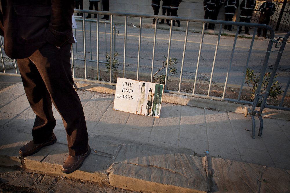 25 February 2011. Valletta, Malta. A cardboard with the faces of North African dictators Ben Ali, Mubarak and Gheddafi is here on the sidewalk in front of the Libyan embassy in Malta. A U.S.-chartered ferry evacuated Americans and other foreigners out of Libya on Friday and brought them to the Mediterranean island of Malta. The Maria Dolores ferry, after three days of delays, brought over 300 passengers, including at 167 U.S. citizens, away from Libya where Colonel Gaddafi's forces continue to clash with anti-government demonstrators.<br /> <br /> <br /> &copy;2011 Gianni Cipriano<br /> cell. +1 646 465 2168 (USA)<br /> cell. +39 328 567 7923<br /> gianni@giannicipriano.com<br /> www.giannicipriano.com