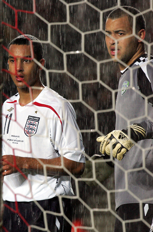 Theo Walcott and Darren Randolph are lost in the rain. England v Republic of Ireland, Uefa Under-21 Championship Qualifier, Tuesday 5th February 2008, St Marys, Southampton.