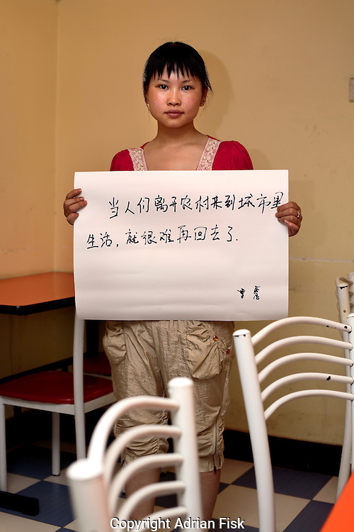 Song Jing Ping - 22 Yrs.<br /> Runs two basic restaurants with her fiancee .<br /> Hubei Province (Migrated from a village 400km away).<br /> <br /> 'When people leave their village to live in the city, it is very hard for them to return'..