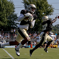 Jul 29, 2013; Metairie, LA, USA; New Orleans Saints cornerback Corey White (24) and defensive back Jerico Nelson (37) catch passes during a morning training camp practice at the team facility.  Mandatory Credit: Derick E. Hingle-USA TODAY Sports