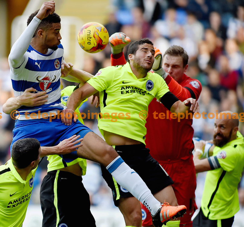 Brighton's Tomer Hemed helps out keeper David Stockdale at a corner during the Sky Bet Championship match between Reading and Brighton and Hove Albion at the Madejski Stadium in Reading. October 31, 2015.<br /> Simon  Dack / Telephoto Images<br /> +44 7967 642437