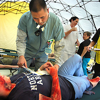 "November 13, 2008, Colton, California, USA - Lionel Lee, Resident Physician at Arrowhead Regional Mecical Center in Colton works with mock earthquake victim Amanda James, a student Redlands Adult School during the Great Southern California Shakeout, which is the largest earthquake drill in history intended to prepared residents for the disaster. More than 469,000 San Bernardino County residents had registered to participate in ""duck, cover and hold on"" events, Thursday, Nov., 13, 2008(Eric Reed/ZUMA Press)"