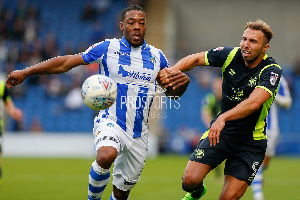 Colchester United's Ryan Jackson(2) Carlisle United's Hallam Hope battles for possessionduring the EFL Sky Bet League 2 match between Colchester United and Carlisle United at the Weston Homes Community Stadium, Colchester, England on 14 October 2017. Photo by Phil Chaplin