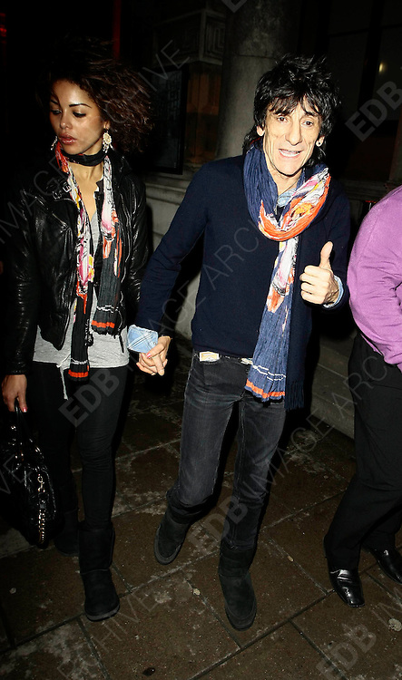 18.MARCH.2010 - LONDON<br /> <br /> RONNIE WOOD AND HIS BRAZILIAN GIRLFRIEND ANA ARAUJO LEAVING THE SHOEBOX ART AUCTION AND EXHIBITION IN MAYFAIR WEARING MATCHING UGG STYLE BOOTS.<br /> <br /> BYLINE: EDBIMAGEARCHIVE.COM<br /> <br /> *THIS IMAGE IS STRICTLY FOR UK NEWSPAPERS &amp; MAGAZINES ONLY*<br /> *FOR OTHER REGIONS PLEASE CONTACT EDBIMAGEARCHIVE - 0208 954 5968*