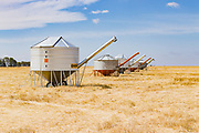 Mobile field bin grain silos in paddock after wheat harvest near Rupanyup, New South Wales, Australia <br />