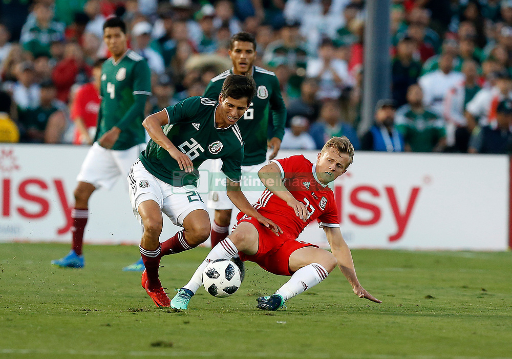 May 28, 2018 - Pasadena, CA, U.S. - PASADENA, CA - MAY 28: Jurgen Damm of Mexico fights George Thomas of Wales for the ball during the game on May 28, 2018, at the Rose Bowl in Pasadena, CA.  (Photo by Adam  Davis/Icon Sportswire) (Credit Image: © Adam Davis/Icon SMI via ZUMA Press)