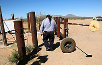 Verlon Jose, vice-chairman of the Tohono O'odham Nation, walks through a gate into Mexico on the U.S. - Mexico border on the Tohono O'odham reservation in Chukut Kuk, Arizona April 6, 2017. Picture taken April 6, 2017.  REUTERS/Rick Wilking