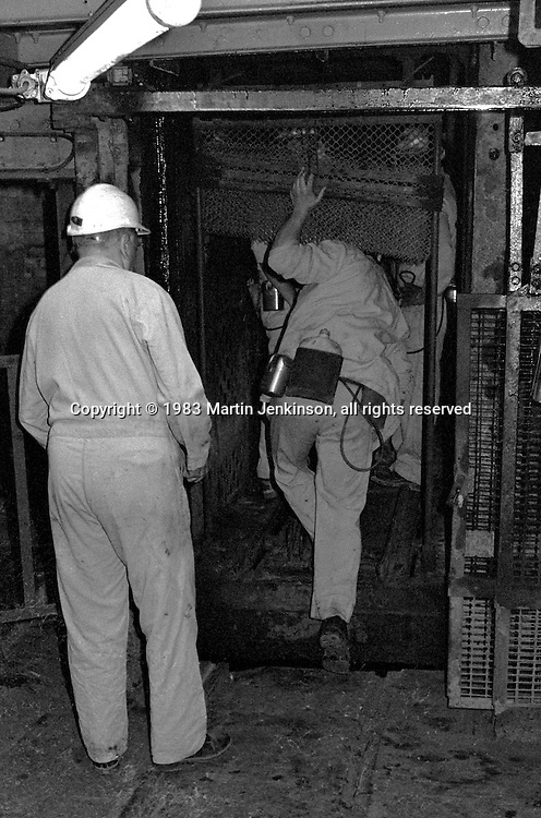 Miner entering the pit cage before going underground at Markham Main Armthorpe Colliery.