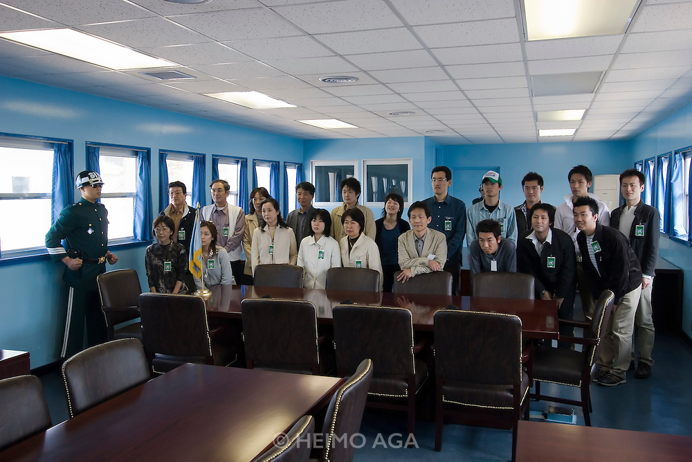 Panmunjom. Joint Security Area. Japanese tour group posing on the North Korean side of the barrack.