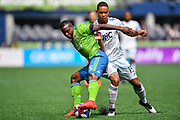 Brandon Bye #15 of New England Revolution and Nouhou Tolo #5 of Seattle Sounders battle for possession during a MLS soccer match on Saturday, Aug. 10, 2019, in Seattle. (Alika Jenner/Image of Sport)