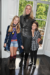 GEORGINA GOODMAN with her daughter SILVA GOODMAN and friend EMILY SALAMON ANDREW at a children's tea party for the English National Ballet hosted by Mortons Private Members Club, Berkeley Square, London on 20th October 2011.