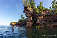 Kayakers exploring the sea caves of Devils Island in the Apostle Islands National Lakeshore, Wisconsin, USA model released