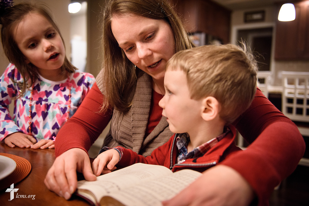 Laurie Vogt sings from the Lutheran Service Book with her children Elizabeth and Carl during an evening devotion with the Congregation at Prayer resource at their home on Sunday, Feb. 7, 2016, in Menomonee Falls, Wis. LCMS Communications/Erik M. Lunsford