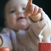 A ten month old baby girl pointing. Photo Tim Clayton