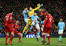 Manchester City goalkeeper Ederson (centre) reaches for the ball during the Premier League match at Anfield, Liverpool.