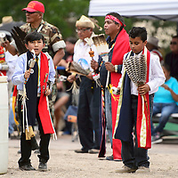 Benton Fatt Jr. 9, left, and Elias Abram, 9, participate in the Honor Gourd Dances at Courthouse Square, as part of the Stars and Stripes 4th of July Celebration Wednesday.