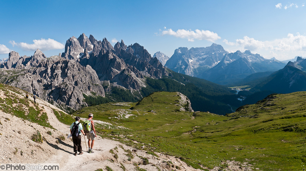 "Cadini di Misurina and the Sorapiss Group rise in the Dolomites mountain range near Cortina d'Ampezzo, Italy, Europe. In the Cadini di Misurina, Cima Grande rises to 2999 meters (9839 feet), between Cima Piccola and Cima Ovest. Hike for spectacular views around Tre Cime di Lavaredo (Italian for ""Three Peaks of Lavaredo,"" also called Drei Zinnen or ""Three Merlons"" in German). The Dolomites were declared a natural World Heritage Site (2009) by UNESCO. Panorama stitched from 4 overlapping photos."