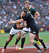 JOHANNESBURG, South Africa, 04 October 2014 : Jan Serfontein of the Springboks is tackled by Beauden Barrett of the All Blacks during the Castle Lager Rugby Championship test match between SOUTH AFRICA and NEW ZEALAND at ELLIS PARK in Johannesburg, South Africa on 04 October 2014. <br /> The Springboks won 27-25 but the All Blacks successfully defended the 2014 Championship trophy.<br /> <br /> © Anton de Villiers / SASPA