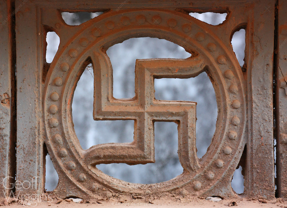 Swastika widely used in Indian religions as a tantric symbol to evoke shakti or the sacred symbol of auspiciousness. Karnataka, India