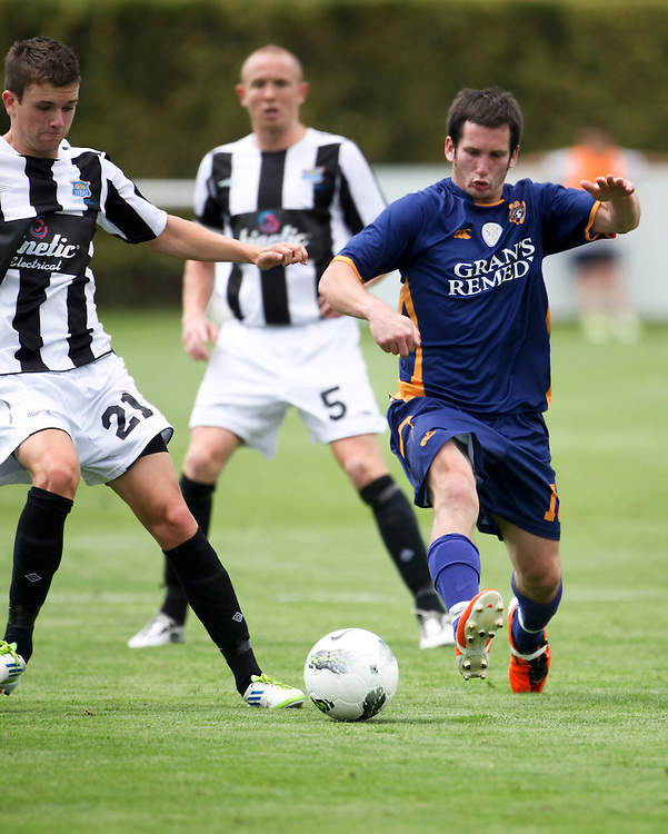 Otago United's Ant Hancock (RIGHT) challenges Hawkes Bay United's Josh Margetts for the ball in the teams ASB Premiership Football match at Park Island, Napier, New Zealand, 12 February 2012, Photo: SNPA / John Cowpland