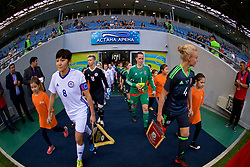 ASTANA, KAZAKHSTAN - Sunday, September 17, 2017: Kazakhstan's captain Begaim Kirgizbaeva and Wales' captain Sophie Ingle lead the teams out before the FIFA Women's World Cup 2019 Qualifying Round Group 1 match between Kazakhstan and Wales at the Astana Arena. (Pic by David Rawcliffe/Propaganda)