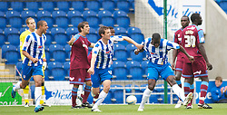 COLCHESTER, ENGLAND - Saturday, September 25, 2010: Things get worse for Tranmere Rovers' players feel dejected as Colchester United's Magnus Okuonghae (C) celebrates after his goal makes it 3-0 during the League One match at the Colchester Community Stadium. (Photo by Gareth Davies/Propaganda)