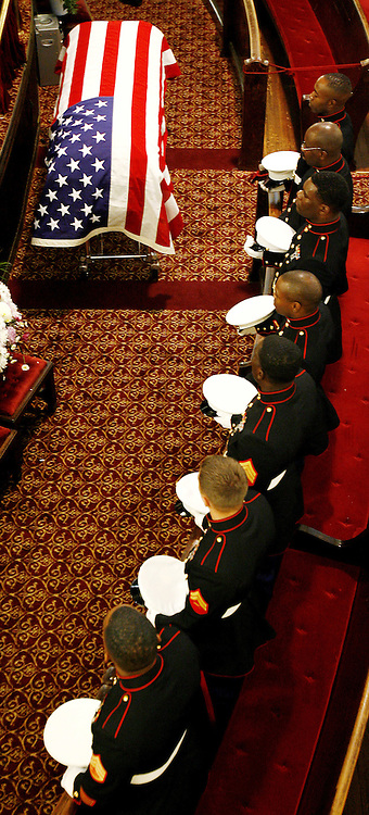United States Marines sit in front of the casket of United States Marine Lance Cpl. Nicholas J. Whyte during his funeral at the Bedford Central Presbyterian Church in Brooklyn, New York on Friday 30 June 2006. Whyte was killed on 21 June 2006 while serving in Iraq.