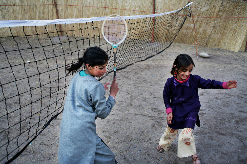 Children play in the grounds of the Thuri Park Relief Camp. The camp houses 2000 people affected by the earthquake of October 8th 2005...Photo: Tom Pietrasik.Muzaffarabad, Pakistani Kashmir. Pakistan.23rd January 2006.