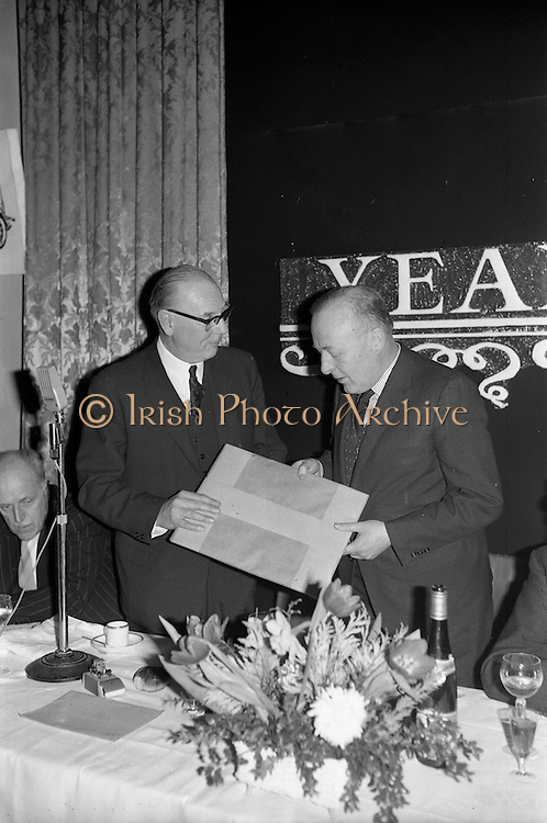 07/02/1963<br /> 02/07/1963<br /> 07 February 1963<br /> Brittain Dublin Ltd. Golden Jubilee reception and Dinner at the Hibernian Hotel, Dublin. Picture shows Mr. C. Kingerlee (left) Private Secretary to Lord Nuffield making a presentation to Mr. G.C.V. Brittain, Director Brittain Dublin Ltd., on behalf of Lord Nuffield.