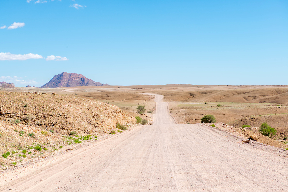 Driving the open road near Solitaire, Namibia