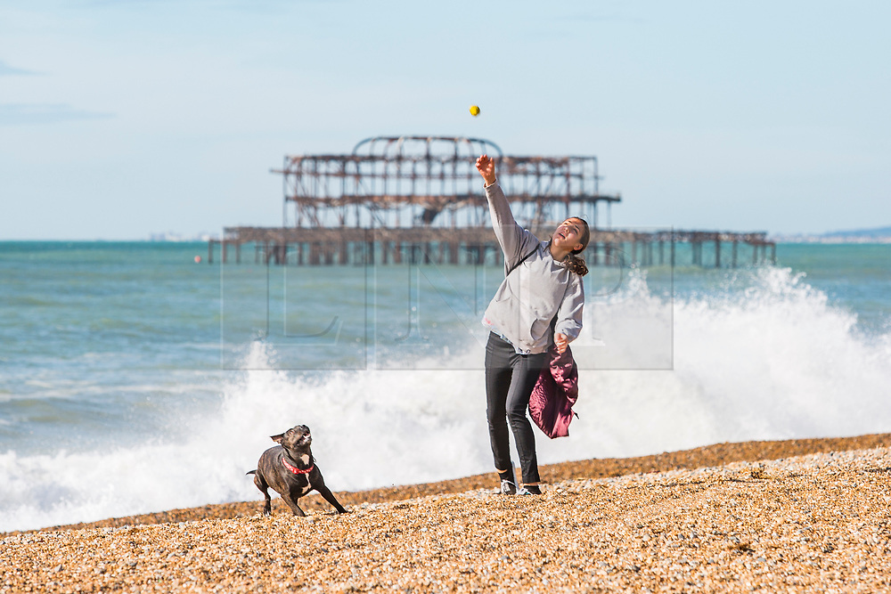 © Licensed to London News Pictures. 05/10/2017. Brighton, UK. a handful of Members of the public relax and enjoy the autumn sunshine on the beach in Brighton and Hove. Photo credit: Hugo Michiels/LNP