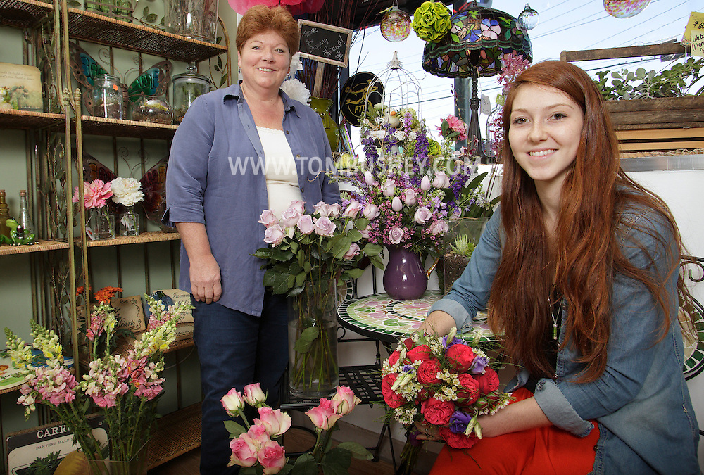 Doris Scholtz, left, and her daughter Alexandra Scholtz pose for a portrait at Florida Flowers and Gifts on Route 94 in Florida on Monday, May 6, 2013. Doris runs the Chester Greenery on Rout 17M in Chester and Alexandra runs the Florida shop.