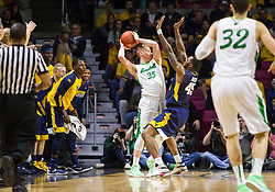 Dec 17, 2015; Charleston, WV, USA; Marshall Thundering Herd guard Austin Loop (35) is trapped in the corner by West Virginia Mountaineers forward Elijah Macon (45) during the first half at the Charleston Civic Center . Mandatory Credit: Ben Queen-USA TODAY Sports