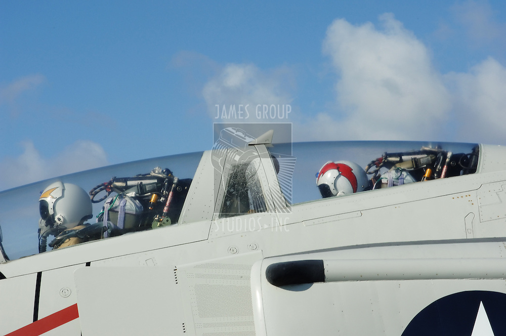 Fighter jet cockpit with profile of pilot and wingman
